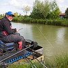 Will Raison plays a hard fighting barbel in the nearside margin beside the pond grass.