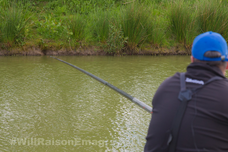 Will Raison ships a rig into position fishing the long pole across to the far bank margin.