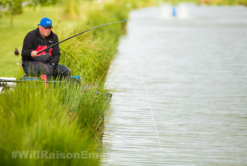 Will Raison hooks a barbel in the margin on a silver painted top kit white Daiwa Hydrolastic stretching form the pole.