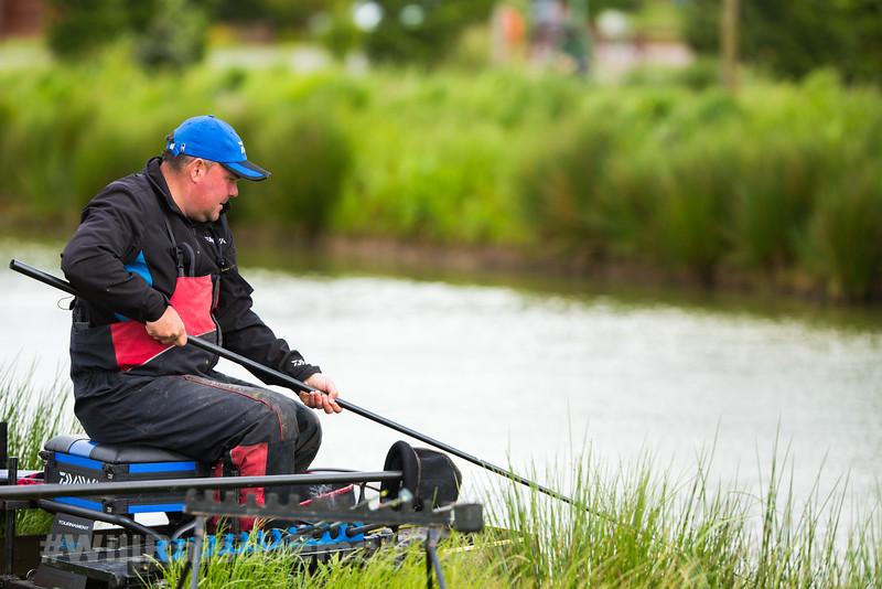 Will Raison ships the short pole having hooked a barbel in the near margin.
