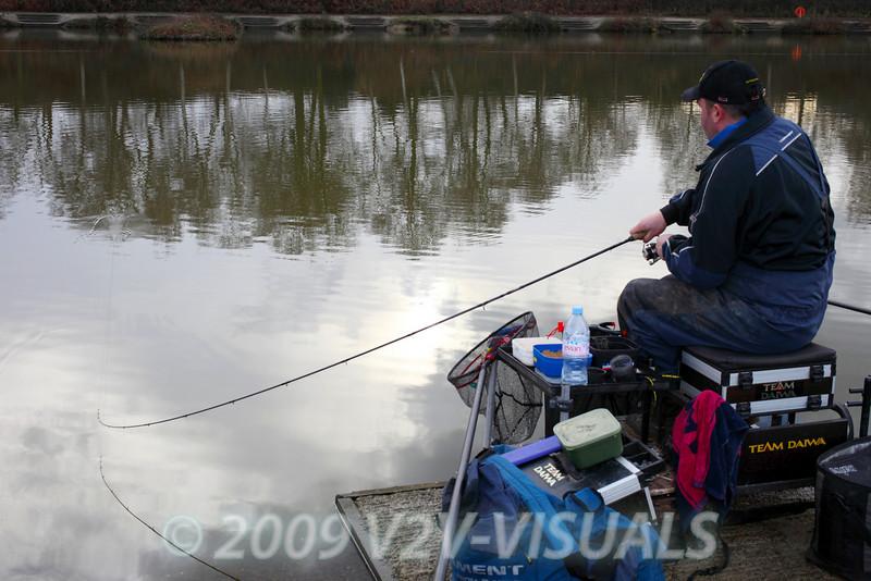 Will Raison fishing Gold Lake in winter. © 2009 Brian Gay