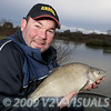 Will Raison fishing Gold Lake in winter. © 2009 Brian Gay