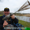 Angler Will Raison holds up a cordless drill fitted with a groundbait mixing whisk. © 2009 Brian Gay