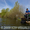 Angler Will Raison plays a carp hooked on mthod feeder running line gear. Middle Lake, Gold Valley, Aldershot, England. © 2009 Brian Gay