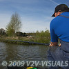 Angler Will Raison ffeding a swim beside an island using a long pole. © 2009 Brian Gay