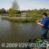 Angler Will Raison stands up to play a carp on the method feeder. Middle Lake, Gold Valley, Aldershot, England. © 2009 Brian Gay