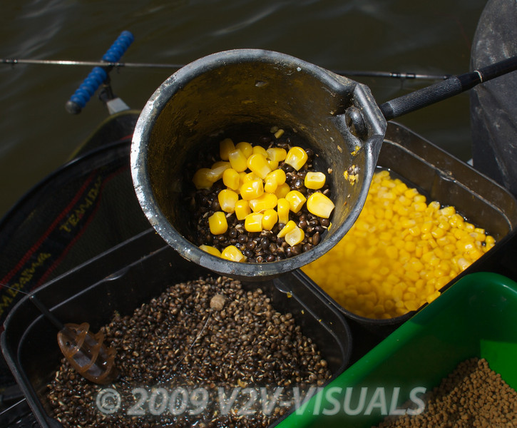 Close-up of a pole cup on the end of a cupping kit, loaded with corn and hemp seed. © 2009 Brian Gay