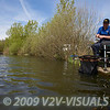 Angler Will Raison plays a carp hooked on method feeder gear. Middle Lake, Gold Valley, Aldershot, England. © 2009 Brian Gay