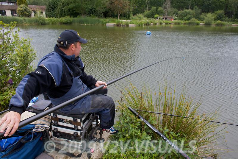 Will Raison plays a good carp on the long pole. © 2009 Brian Gay