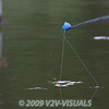 Close-up of the pole tip with the the hook bait in the cup about to be tipped into the swim. © 2009 Brian Gay