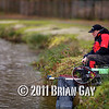 watching the rod tip waiting for a bite, Will Raison fishes a small cage feeder with dead maggots and fishmeal for bream. © 2012 Brian Gay