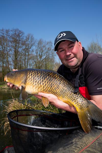 Will Raison holds a common carp.