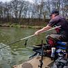 Will Raison plays slides the landing net towards a carp using the Tournament Pro 1011Q  Feeder rod.