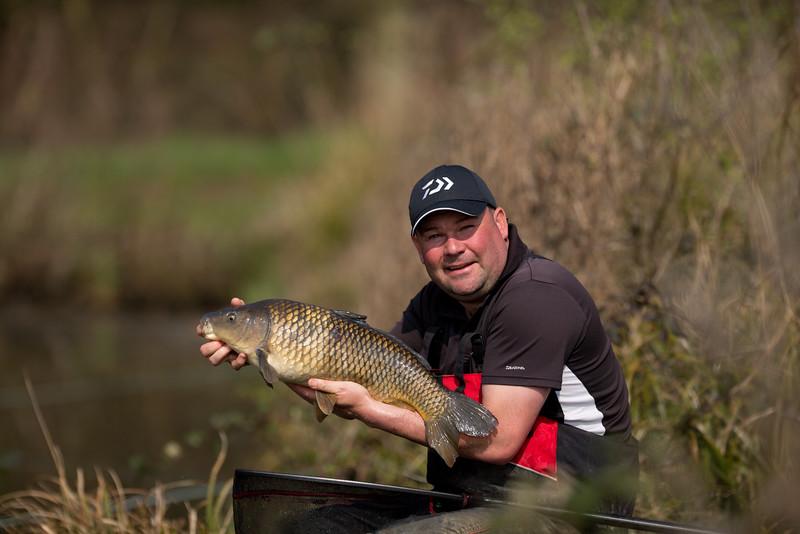 Will Raison holds a nice common carp