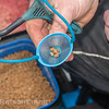 Light but  regular feeding is essential in open water,  close-up of 4 mm pellets in a catapult pouch,