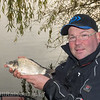 Will Raison holds a typical F1 carp from Middle Lake at Gold Valley.