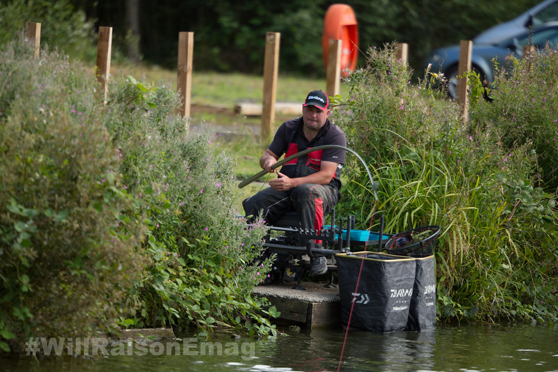 Pole bends and red Hydrolastic stretches as a hard fighting carp is hooked in the margins.