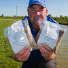 Will Raison holds Westwood Lakes Coarse Pellets 2.3 mm and 4.5 mm in kilo bags