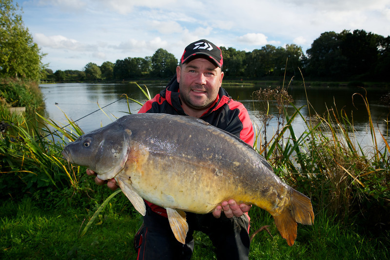 Will Raison poses with a 19 lb carp