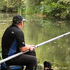 Will Raison plumbs up the left hand far swim with the long pole on the Basingstoke Canal at Claycart.