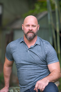 Handsome mature man with bald head and full beard