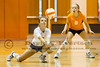 August 8,2012 - Boone JV Volleyball player Morgan Smith (8) looks on as teammate  Ashlyn McCrory (6) digs the ball down low during a match against Lake Nona at William R. Boone High School. The Boone JV team eventually ended up losing the match in two straight games.
