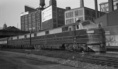 2013.010.BO.D.0066--bill kuba 116 neg--B&O--EMD diesel locomotive 66 on passenger train at station scene--Philadelphia PA--1956 0520