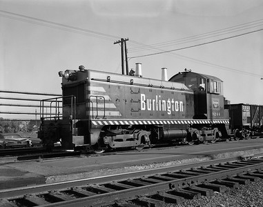 2013.010.CBQ.D.9244--bill kuba 4x5 neg--CB&Q--EMD diesel switcher locomotive 9244--Aurora IL--1964 1009