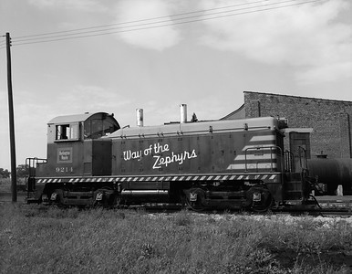 2013.010.CBQ.D.9214--bill kuba 4x5 neg--CB&Q--EMD diesel switcher locomotive 9214--Eola IL--1964 0916