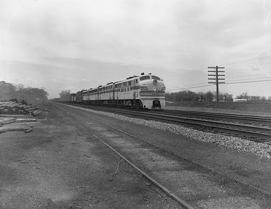 2013.010.CBQ.D.0117D--bill kuba 4x5 neg--CB&Q--EMD diesel locomotive 117D on freight train--Naperville IL--1961 0300