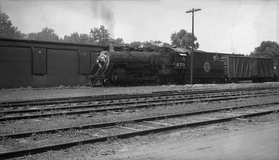 2013.010.CGW.S.0270--bill kuba 116 neg--CGW--steam locomotive 2-6-2 270 on freight train in yard--location unknown--no date