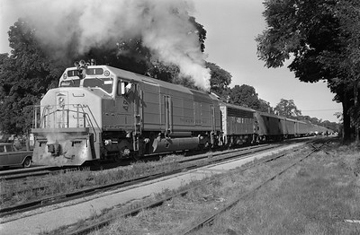 2013.010.MILW.D.0001--bill kuba 6x9 neg--CMStP&P--EMD diesel locomotive 1 on passenger train 104--Marion IA--1969 0628