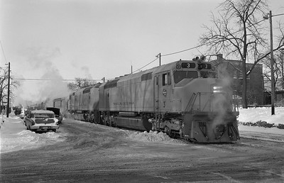 2013.010.MILW.D.0003A--bill kuba 6x9 neg--CMStP&P--EMD diesel locomotive 3 on first eastbound run on passenger train 112--Marion IA--1969 0101