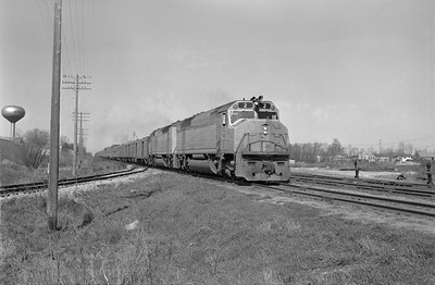 2013.010.MILW.D.0002--bill kuba 6x9 neg--CMStP&P--EMD diesel locomotive 2 on passenger train 104--Marion IA--1969 0200