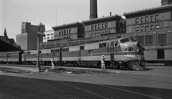 2013.010.MILW.D.0016A--bill kuba 6x9 neg--CMStP&P--EMD diesel locomotive 16A on passenger train at station--Milwaukee WI--1950 0821