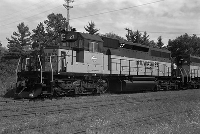 2013.010.MILW.D.0027--bill kuba 6x9 neg--CMStP&P--EMD diesel locomotive 27--Iron Mountain MI--1973 0730