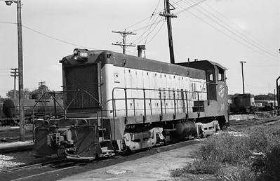 2013.010.CNW.D.0099--bill kuba 6x9 neg--C&NW--BLW diesel switcher locomotive 99--Council Bluffs IA--1973 0525