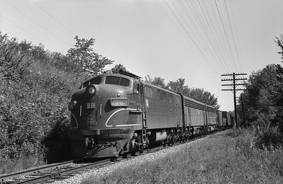 2013.010.CRIP.D.0098--bill kuba 6x9 neg--CRI&P--EMD diesel locomotive 98 on westbouund freight train 98 at waterworks--Cedar Rapids IA--1964 0830