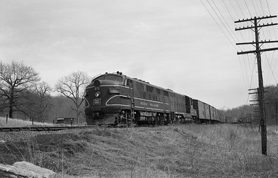 2013.010.CRIP.D.0045A--bill kuba 6x9 neg--CRI&P--EMD diesel locomotive 45 on westbound freight train 99--Linn Jct IA--1964 0416