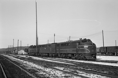 2013.010.CRIP.D.0077--bill kuba 6x9 neg--CRI&P--EMD diesel locomotive 77 at shops--Cedar Rapids IA--1963 0216