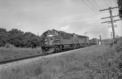 2013.010.CRIP.D.0046--bill kuba 6x9 neg--CRI&P--EMD diesel locomotive 46 on westbound freight train 81--Oxford IA--1963 0812