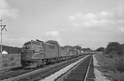 2013.010.CRIP.D.0074--bill kuba 6x9 neg--CRI&P--EMD diesel locomotive 74 on westbound freight train 99--Cedar Rapids IA--1964 0823