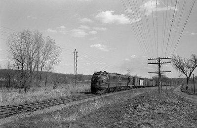 2013.010.CRIP.D.0075--bill kuba 6x9 neg--CRI&P--EMD diesel locomotive 75 on westbound freight train 99--Linn Jct IA--1963 0413