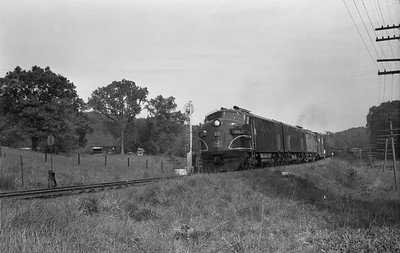 2013.010.CRIP.D.0088--bill kuba 6x9 neg--CRI&P--EMD diesel locomotive 88 on westbound freight train 99--Linn Jct IA--1963 0601