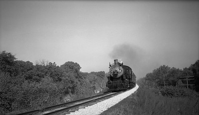 2013.010.CRIP.AS.2123--bill kuba PC neg [Joseph Sleger]--CRI&P--steam locomotive 2-8-0 C-43 2123 on southbound passenger train at Prairie Creek action--Cedar Rapids IA--1943 1015