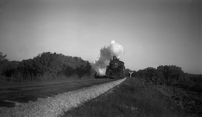 2013.010.CRIP.AS.0897--bill kuba PC neg [Joseph Sleger]--CRI&P--steam locomotive 4-6-2 P-33 897 on southbound passenger train 64 action--near Cedar Rapids IA--1944 1022