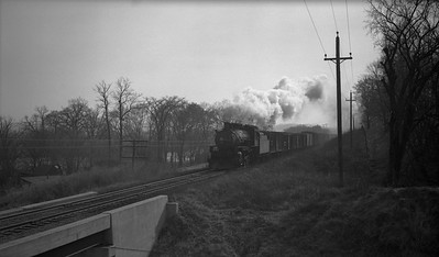 2013.010.CRIP.AS.2049--bill kuba PC neg [Joseph Sleger]--CRI&P--steam locomotive 2-8-0 C-43 2049 on northbound freight train at Stumptown action--Cedar Rapids IA--1942 1108