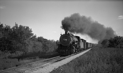 2013.010.CRIP.AS.2627--bill kuba PC neg [Joseph Sleger]--CRI&P--steam locomotive 2-8-2 K-64 2627 on northbound freight train action at Prairie Creek--Cedar Rapids IA--1943 1003