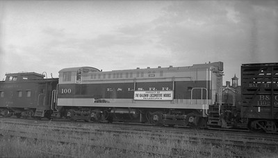 2013.010.ELS.D.100A--bill kuba 116 neg--E&LS--BLW diesel switcher locomotive 100 new on delivery in B&O freight train--location unknown--no date