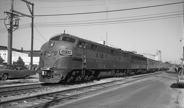 2013.010.GMO.D.0103A--bill kuba 116 neg--GM&O--EMD diesel locomotive 103A on passenger train--Springfield IL--1973 1020